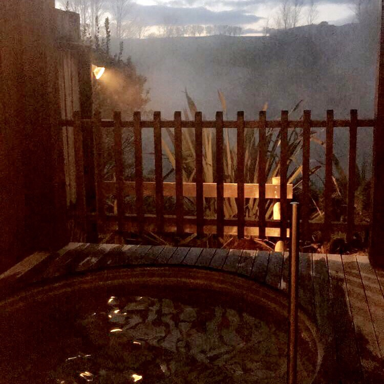 A private thermal pool with a scenic view as the sun goes down